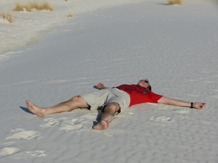 Patrick spread eagle on the sand