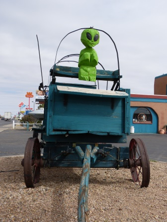 Little green man driving a old wagon