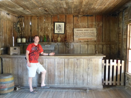 Patrick standing at the bar inside a wooden building